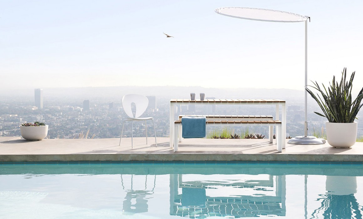 Deneb table and benches by the pool of the Stahl house, Los Angeles